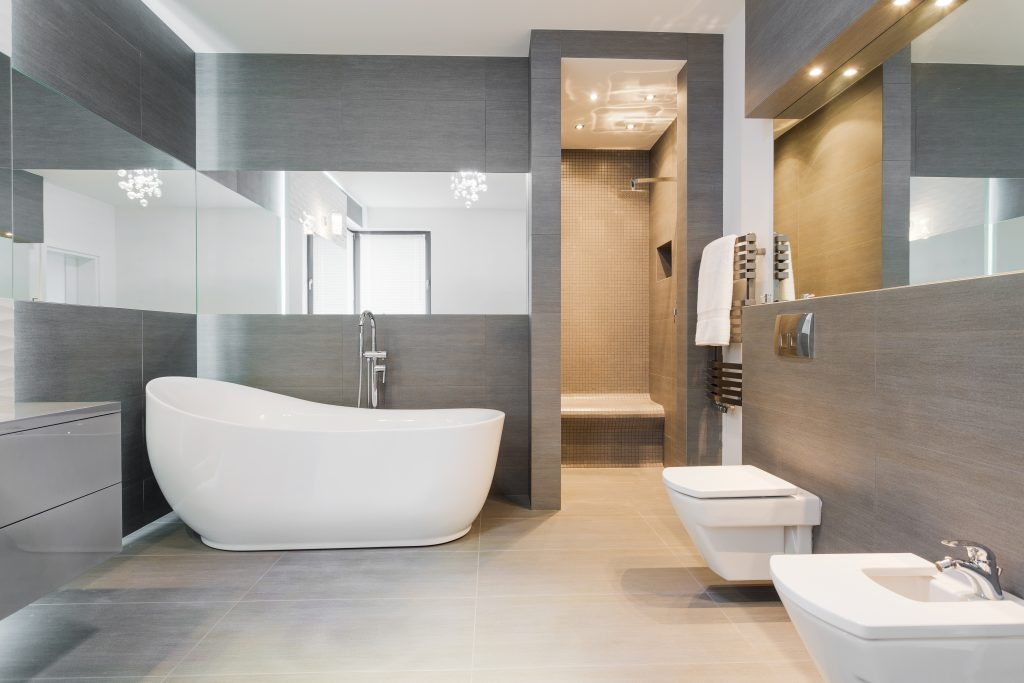 Freestanding bath in modern bathroom team logue