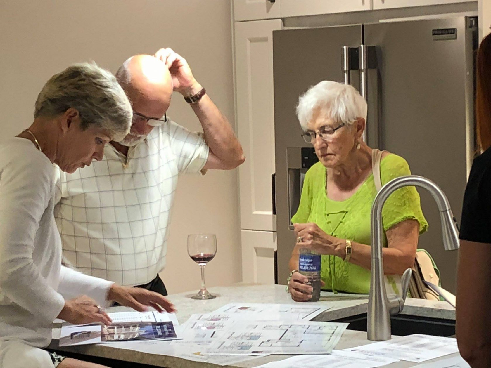 Reviewing floor plans at the Colonnade open house | Team Logue Burlington Real Estate